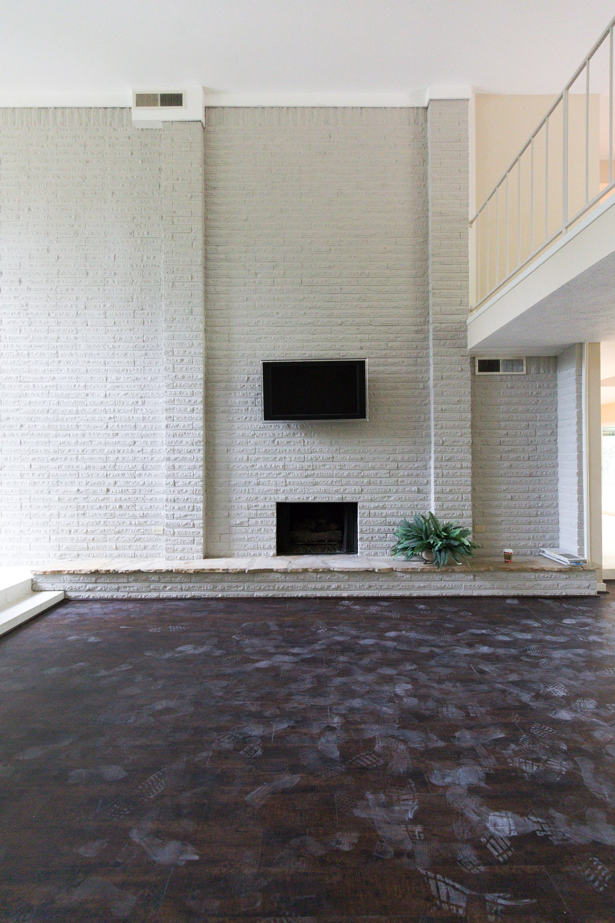 the fire place wall - One Room Challenge Week 1: The Before Photos of Our Living Room + Dining Room by top Houston lifestyle blogger Ashley Rose of Sugar and Cloth #decor #homedecor #diy #interiors #renovations