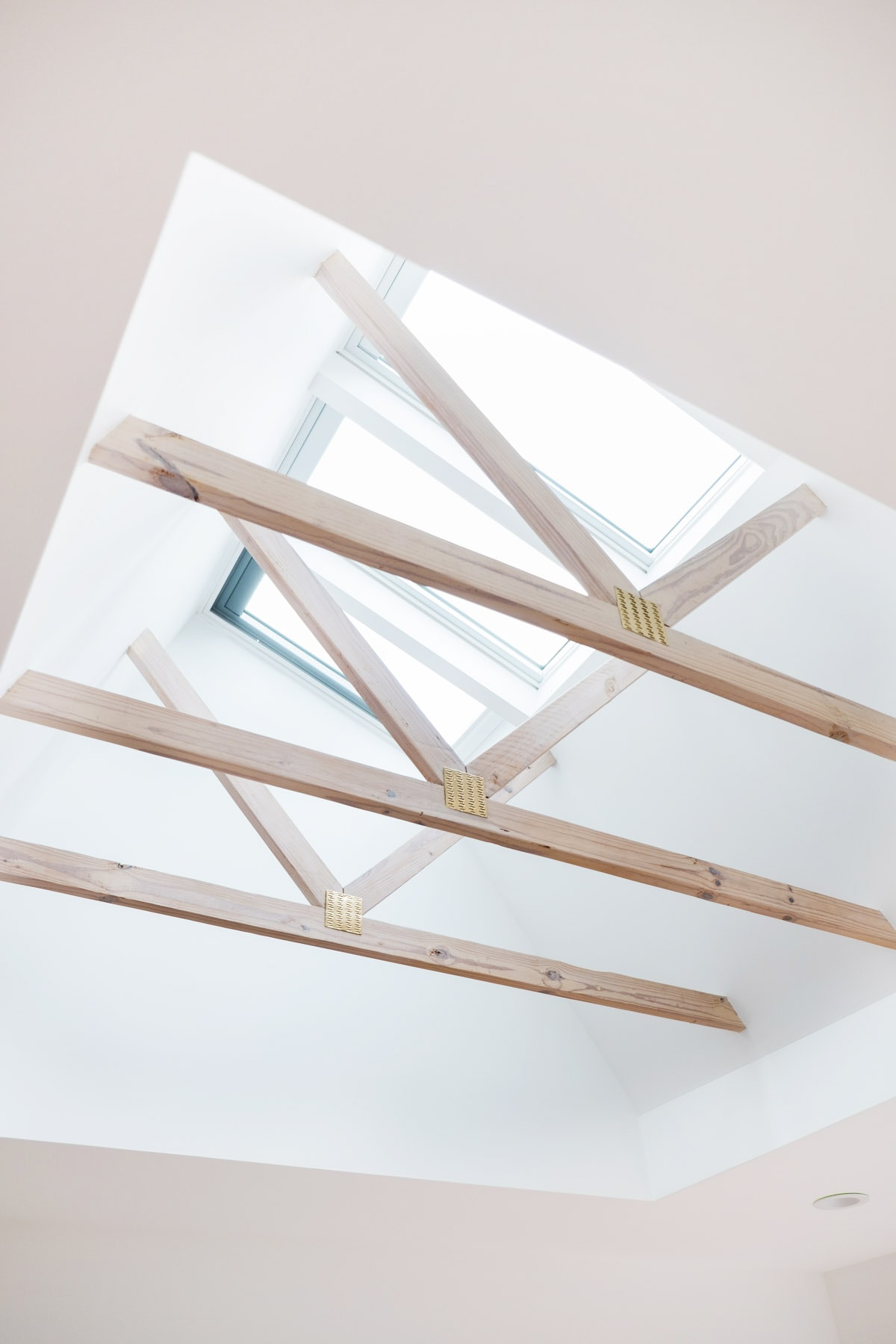 The whitewashed beams in the master bedroom - Sugar & Cloth Casa: Before & After of Installing Skylights in The New House