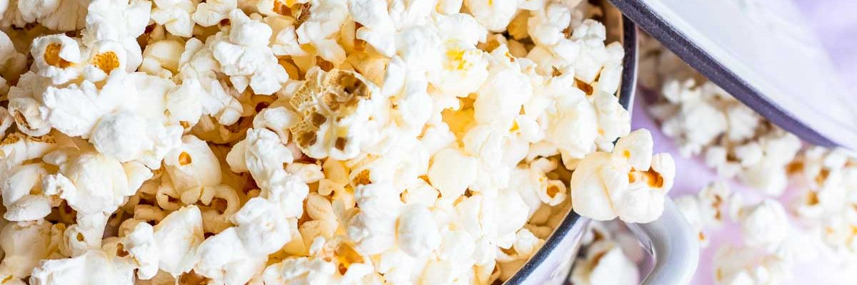 overhead photo of flavored popcorn by sugar and cloth