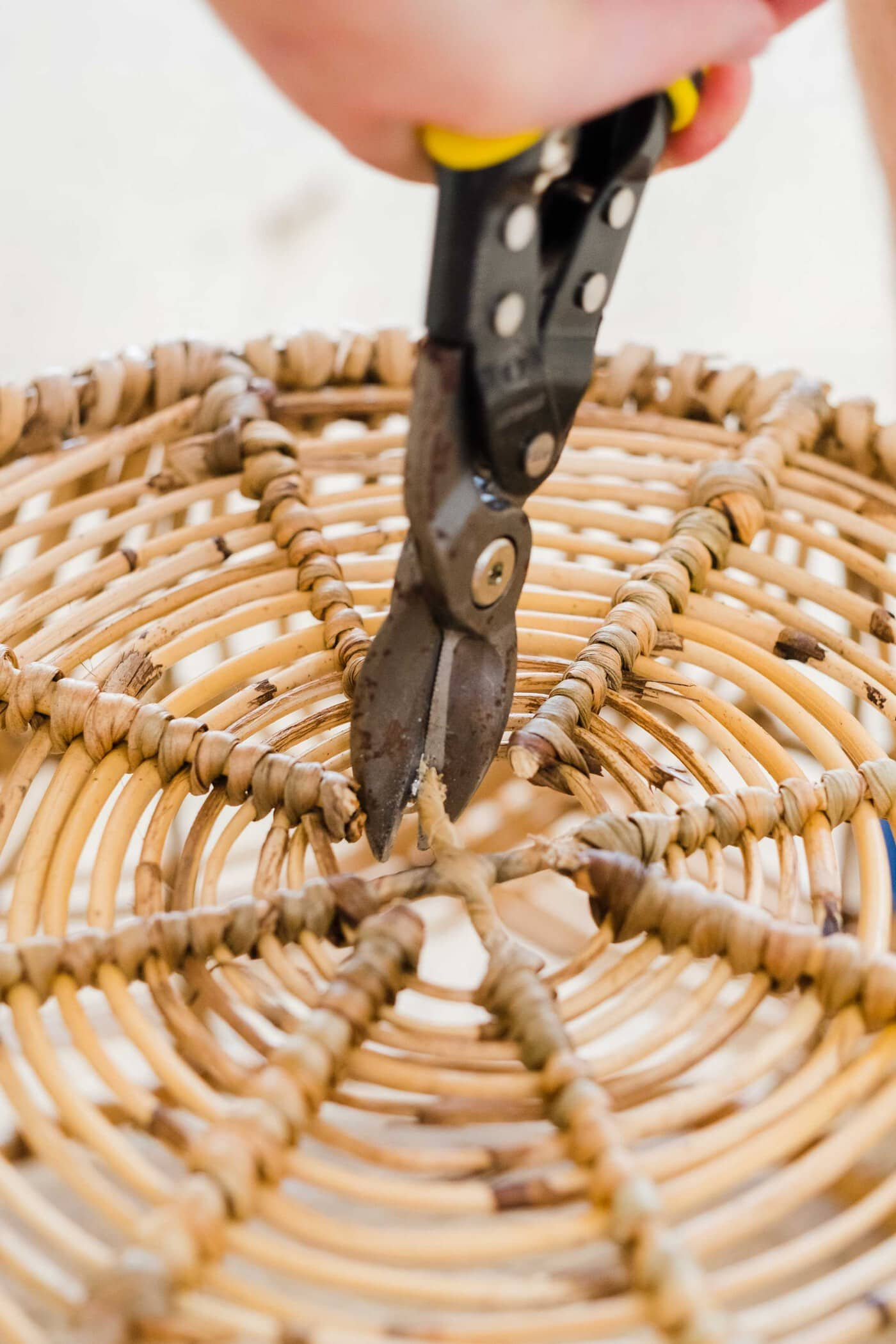 picture of how to cut the bottom center of a basket for the DIY basket light by Sugar & Cloth