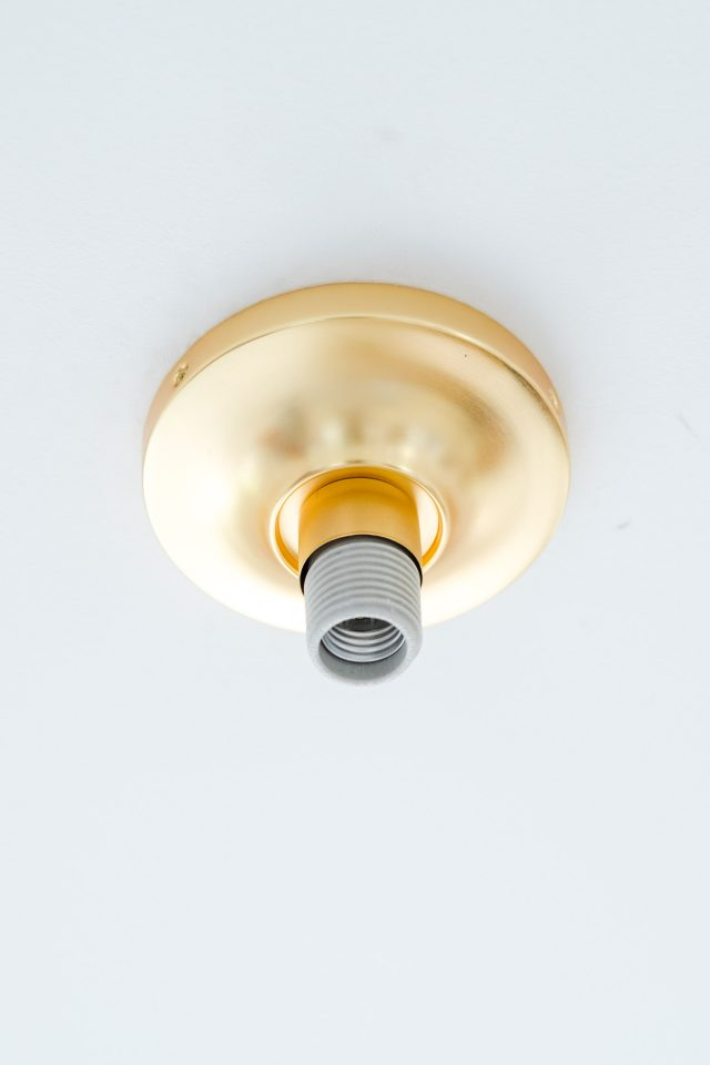 picture of how to install the DIY basket pendant light fixture to the ceiling by Sugar & Cloth