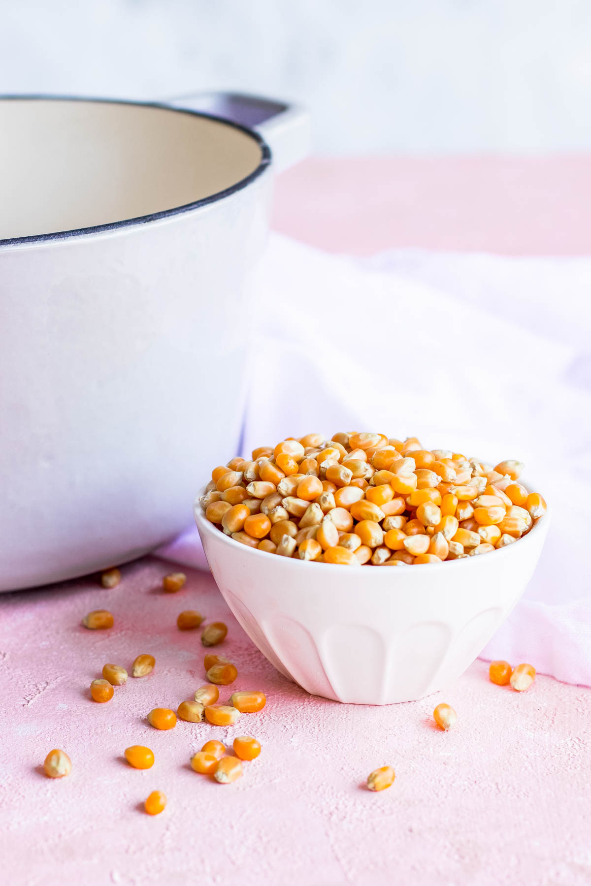 photo of unpopped popcorn kernels by sugar and cloth