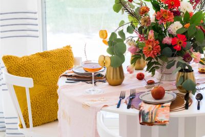 horizontal photo of a DIY table runner and fall table decor setting