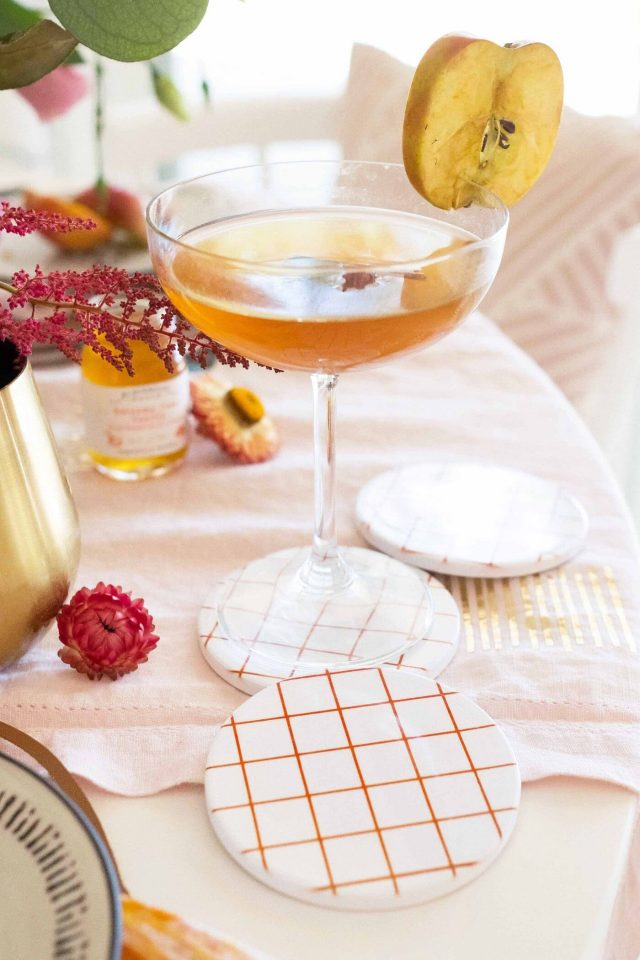 close up photo of a cocktail and DIY coasters made with cricut infusible ink by sugar and cloth