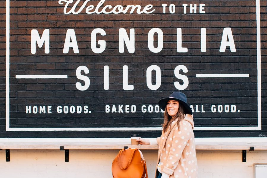 photo of a girl sitting at magnolia silos baking co