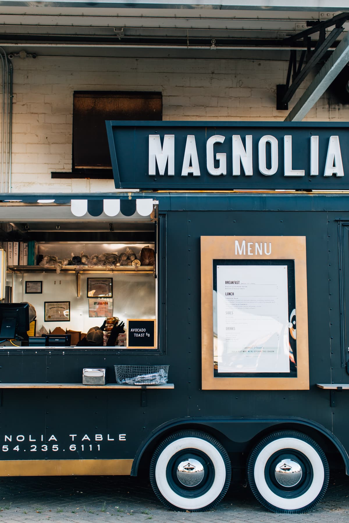 order food from the Take Away if you can't get a seat at the Magnolia Table restaurant from our for Texas Monthly guide