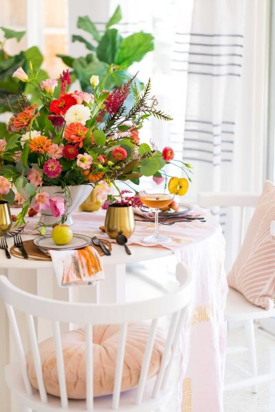 photo of the corner of a decorated fall dining table by sugar and cloth in houston