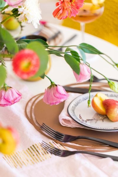 close up picture of fall table decor flowers by sugar and cloth