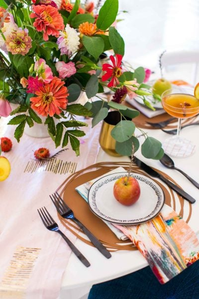 picture of a fall flower arrangement at a place setting by sugar and cloth