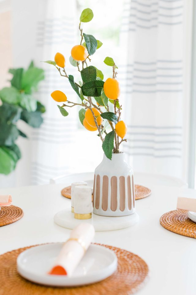 a picture of the table centerpiece below the DIY pendant light fixture by Sugar & Cloth