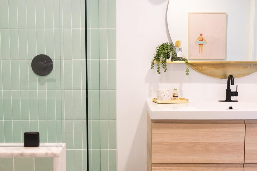 vertical photo of our walk in shower and new vanity from our guest bathroom remodel