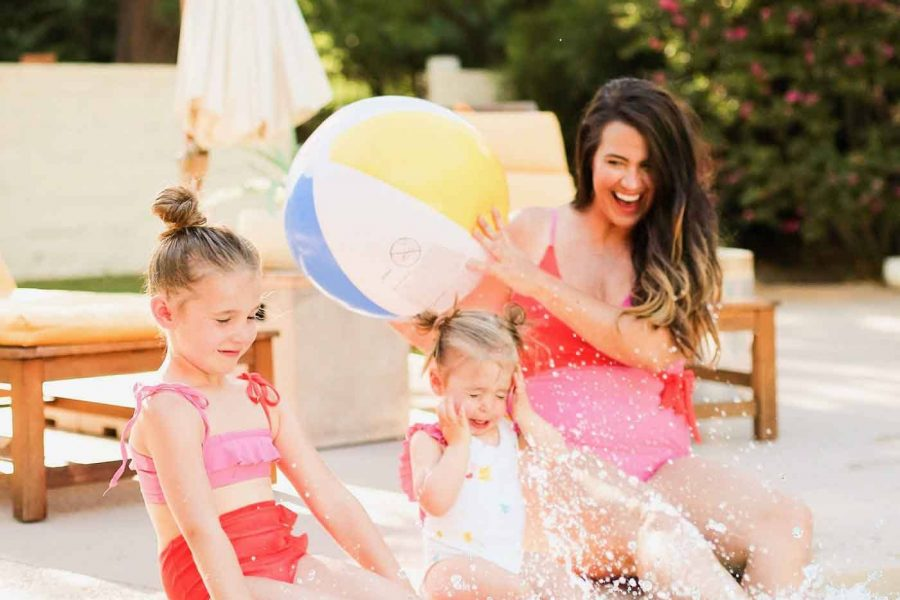 photo of a mom and daughters in mommy and me swimsuits from olivia and ocean by sugar and cloth