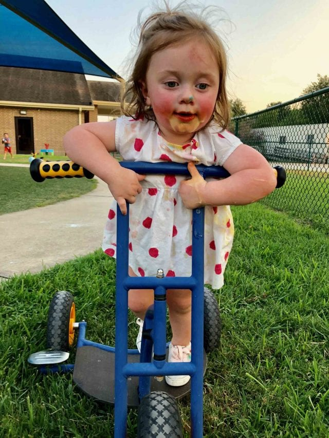 photo of girl with popsicle on her face
