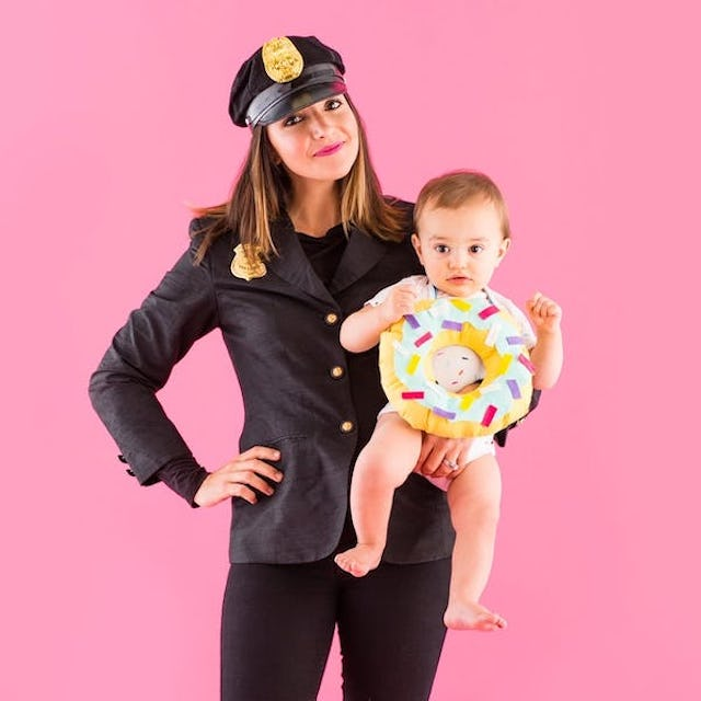 Family Halloween Costume: Photo of mom dresses ad police officer holding baby dressed as donut