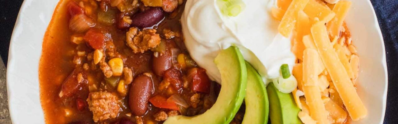 main photo of the Best Easy Turkey Chili by top Houston lifestyle blogger Ashley Rose of Sugar & Cloth