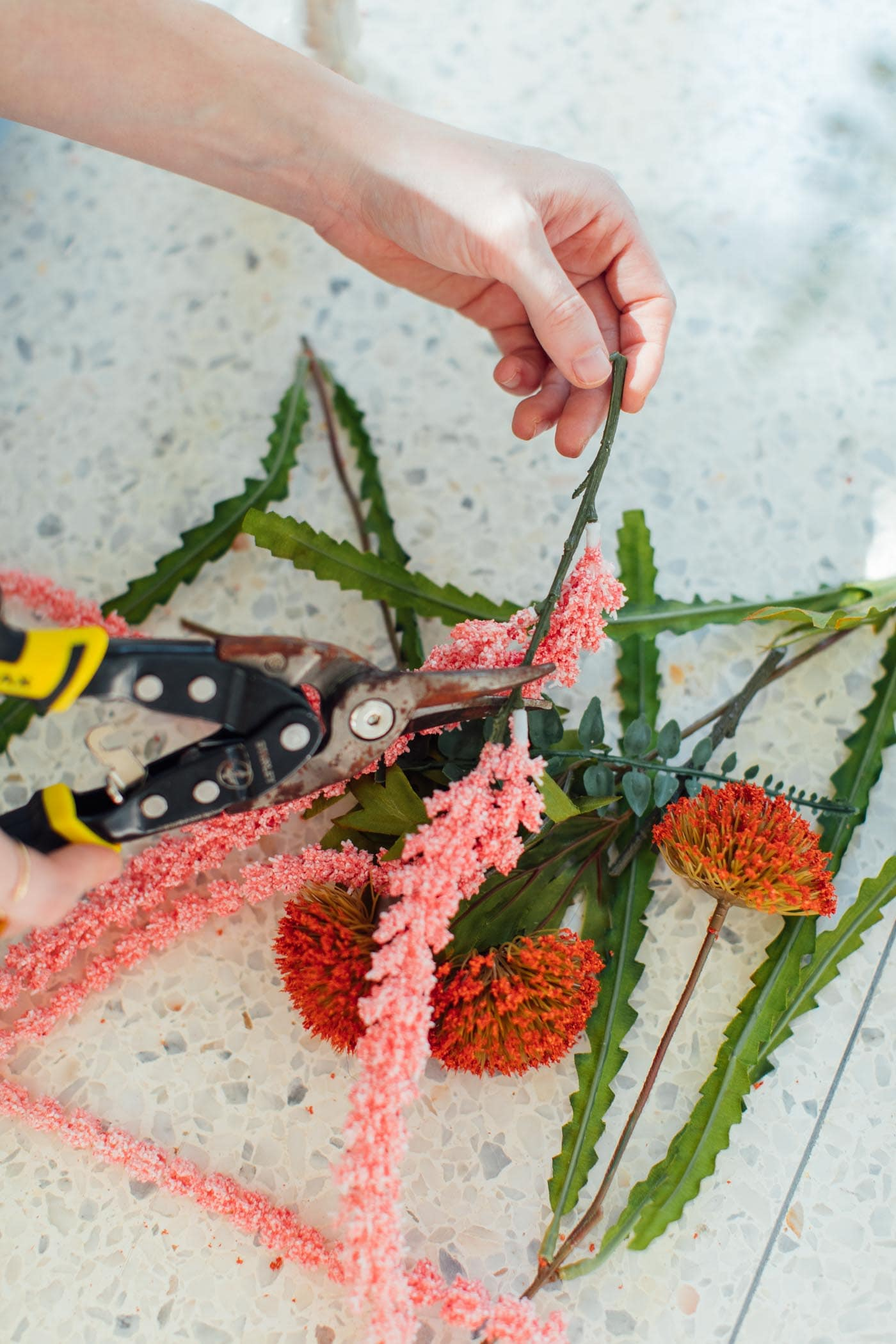 photo of a girl cutting fake flowers