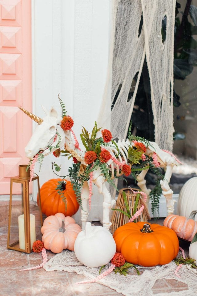 photo of a pink door with halloween door decor