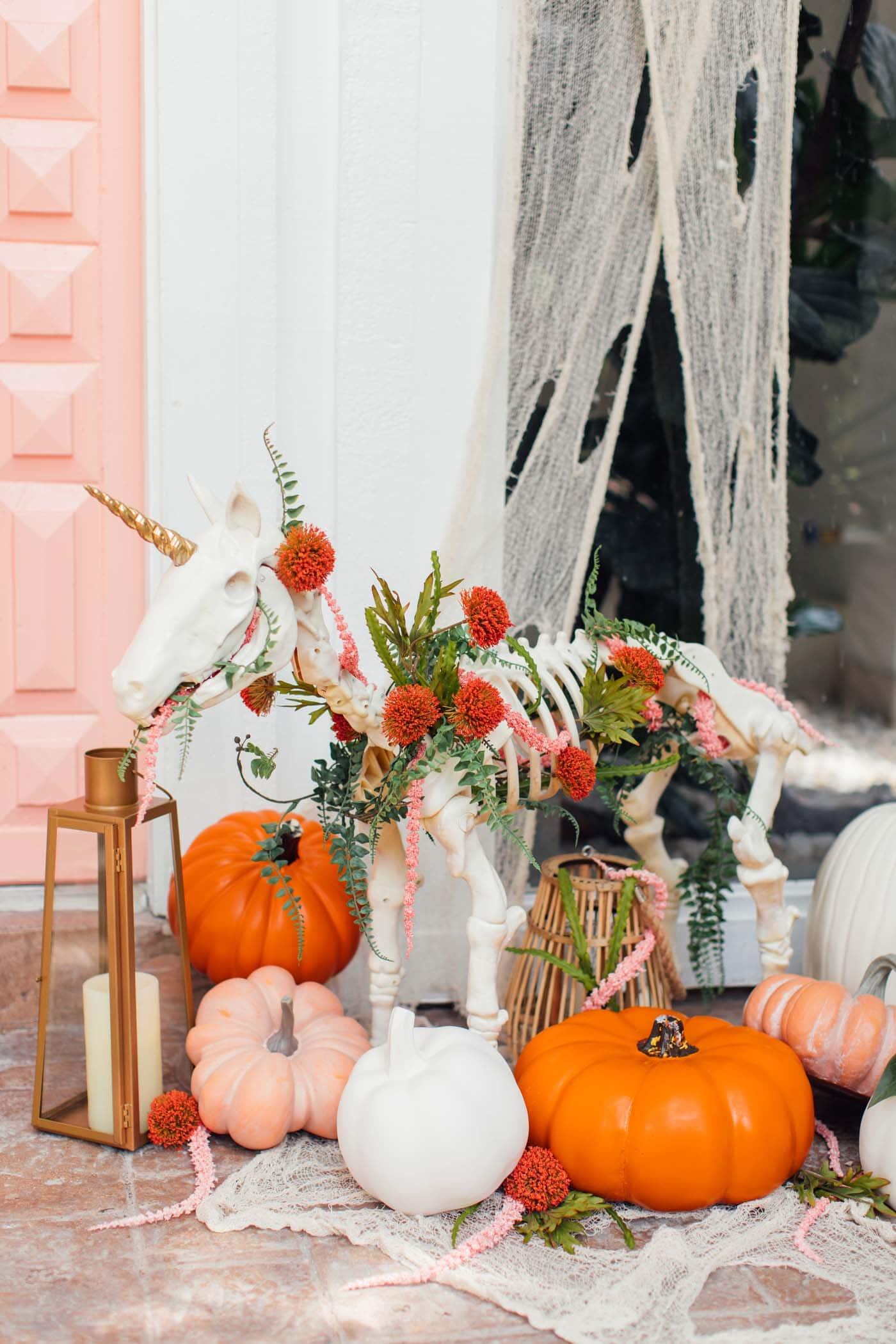 photo of a pink door with halloween door decor