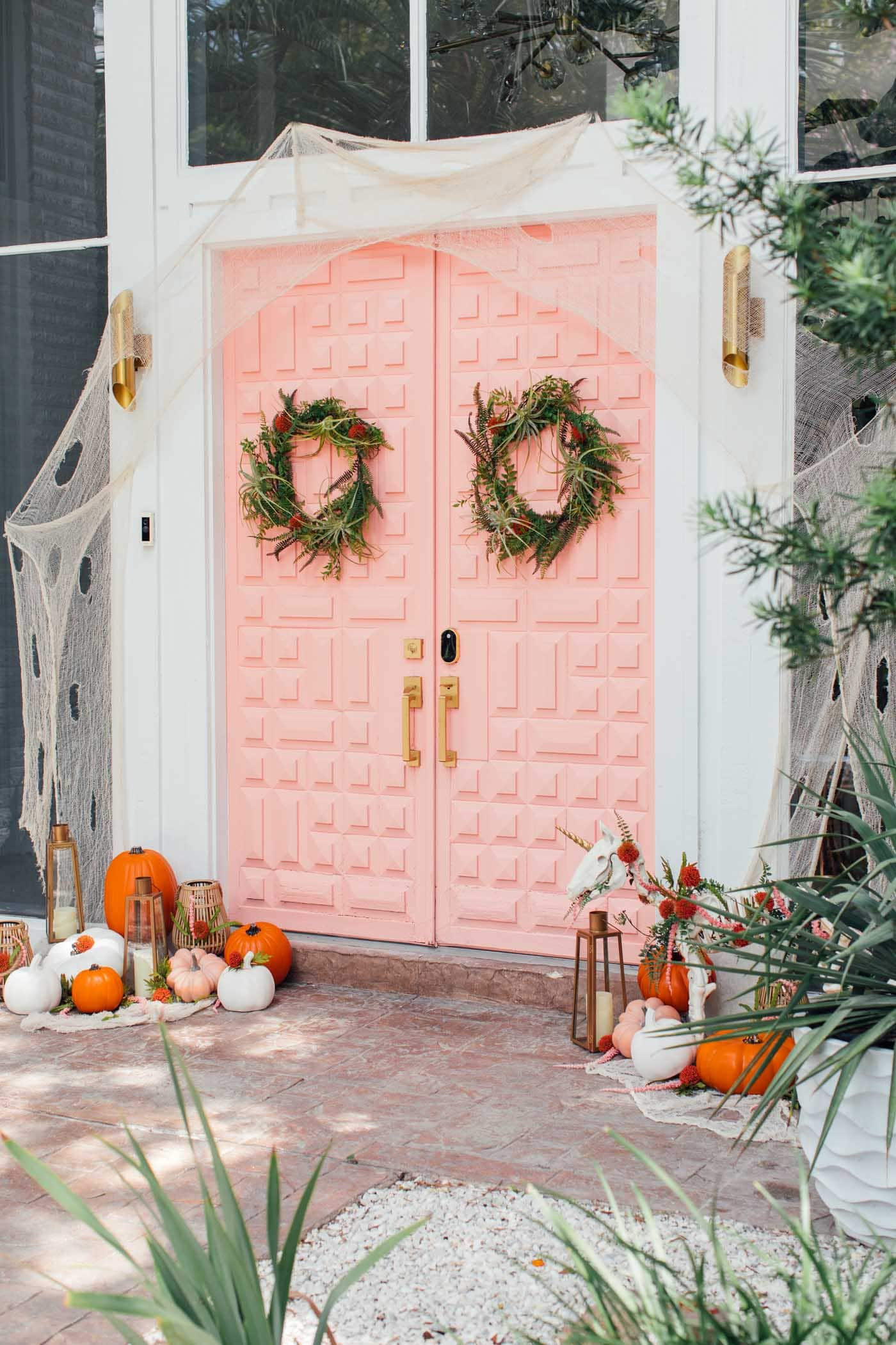 photo of a pink door with halloween decorations