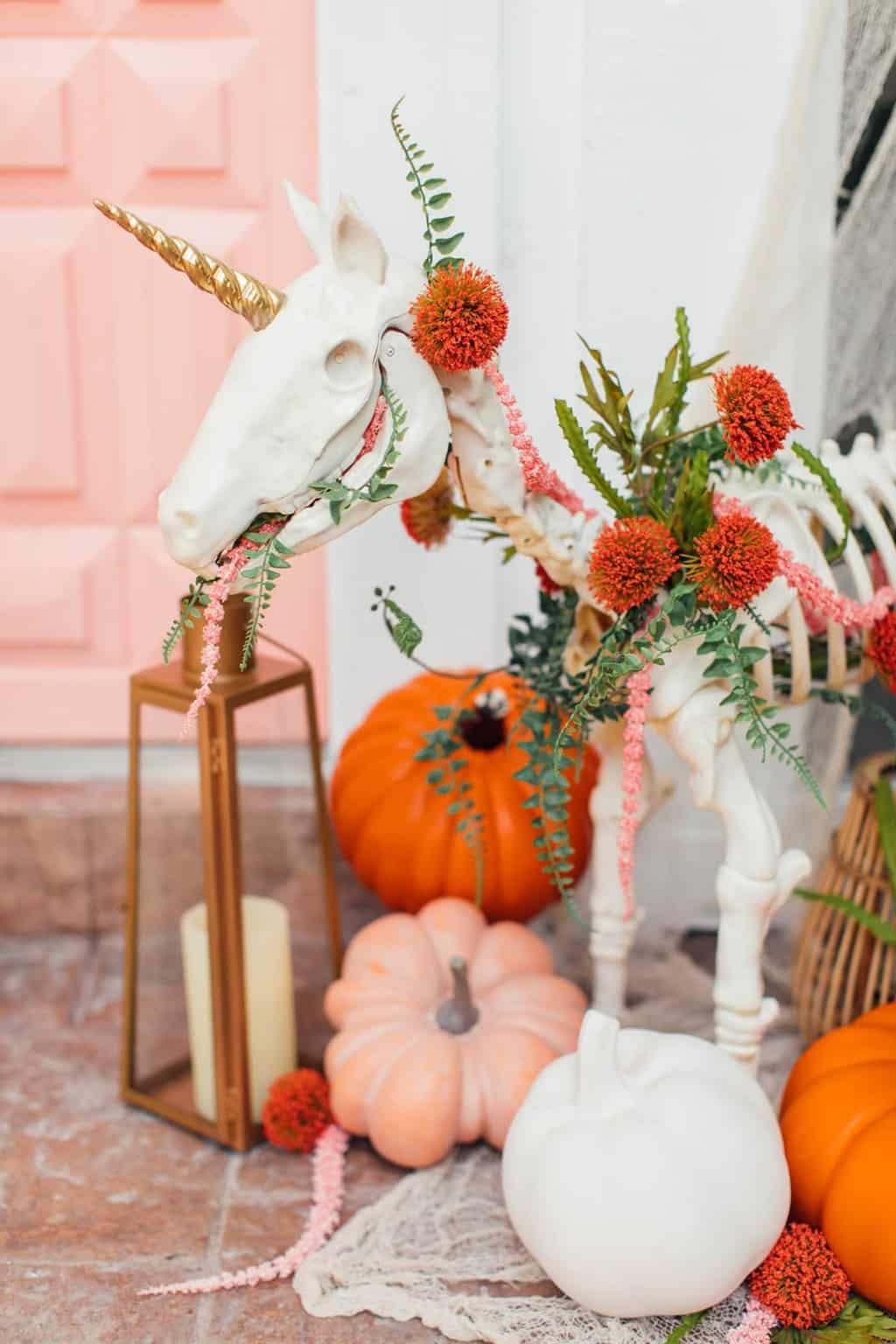 photo of a unicorn skeleton and halloween front door decor