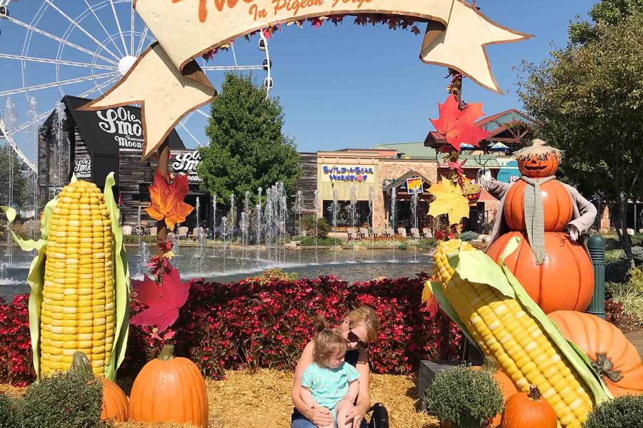 photo of a girl and grandma in pigeon forge with pumpkins