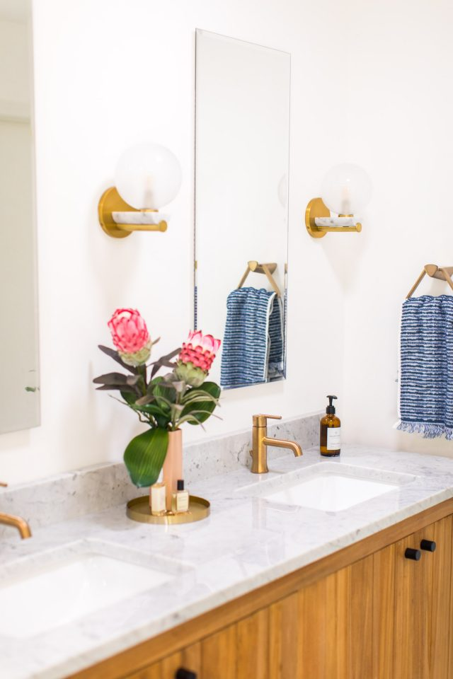 photo of flowers on bathroom vanity