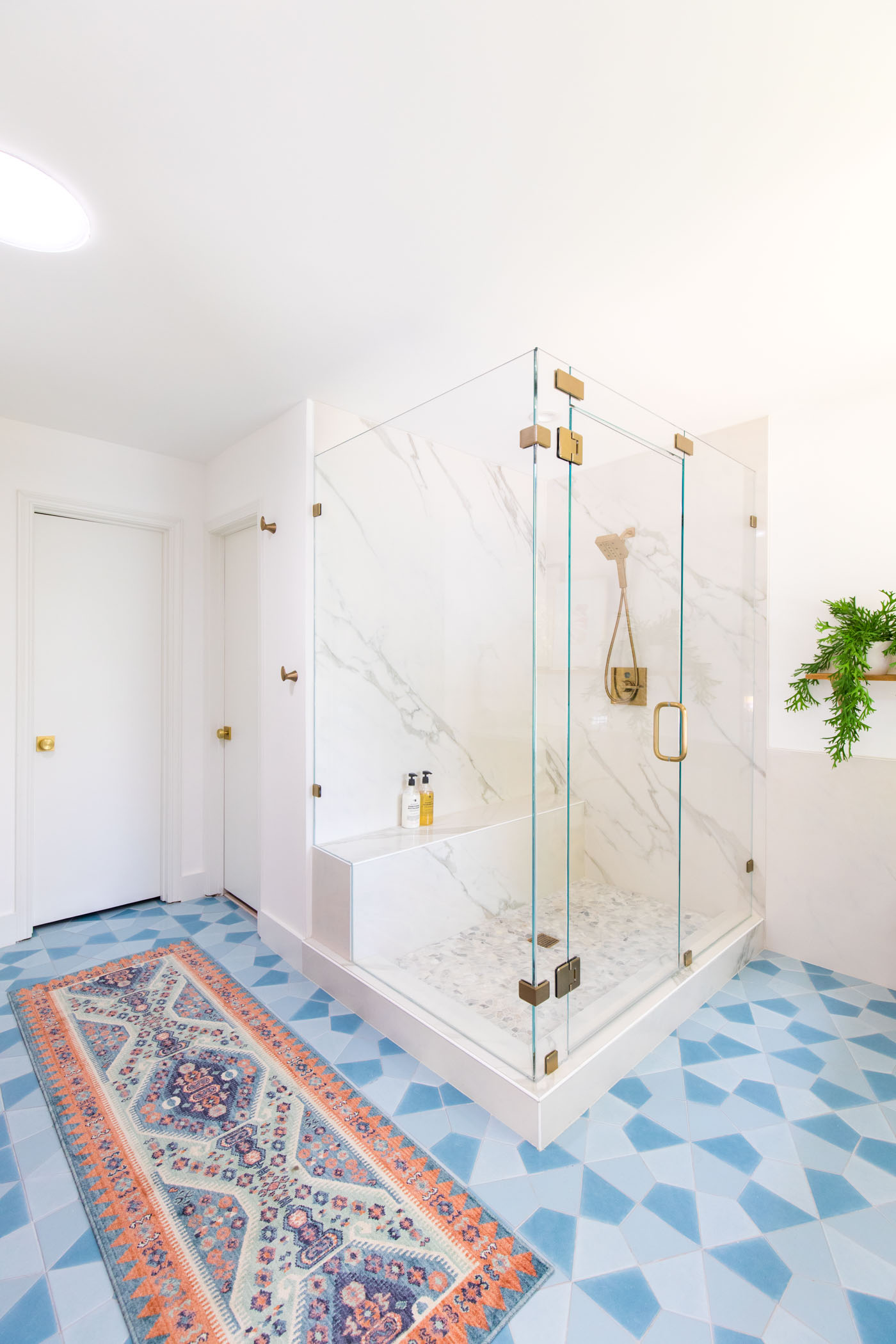 photo of a marble wall panel from porcelain shower walls in a master bathroom remodel