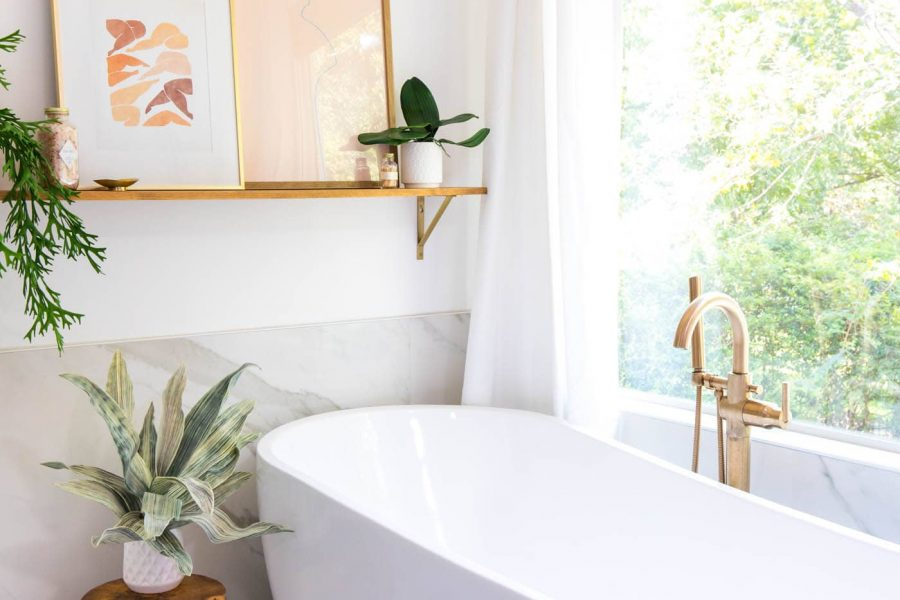photo of a bathtub and wall ledge in master bathroom remodel