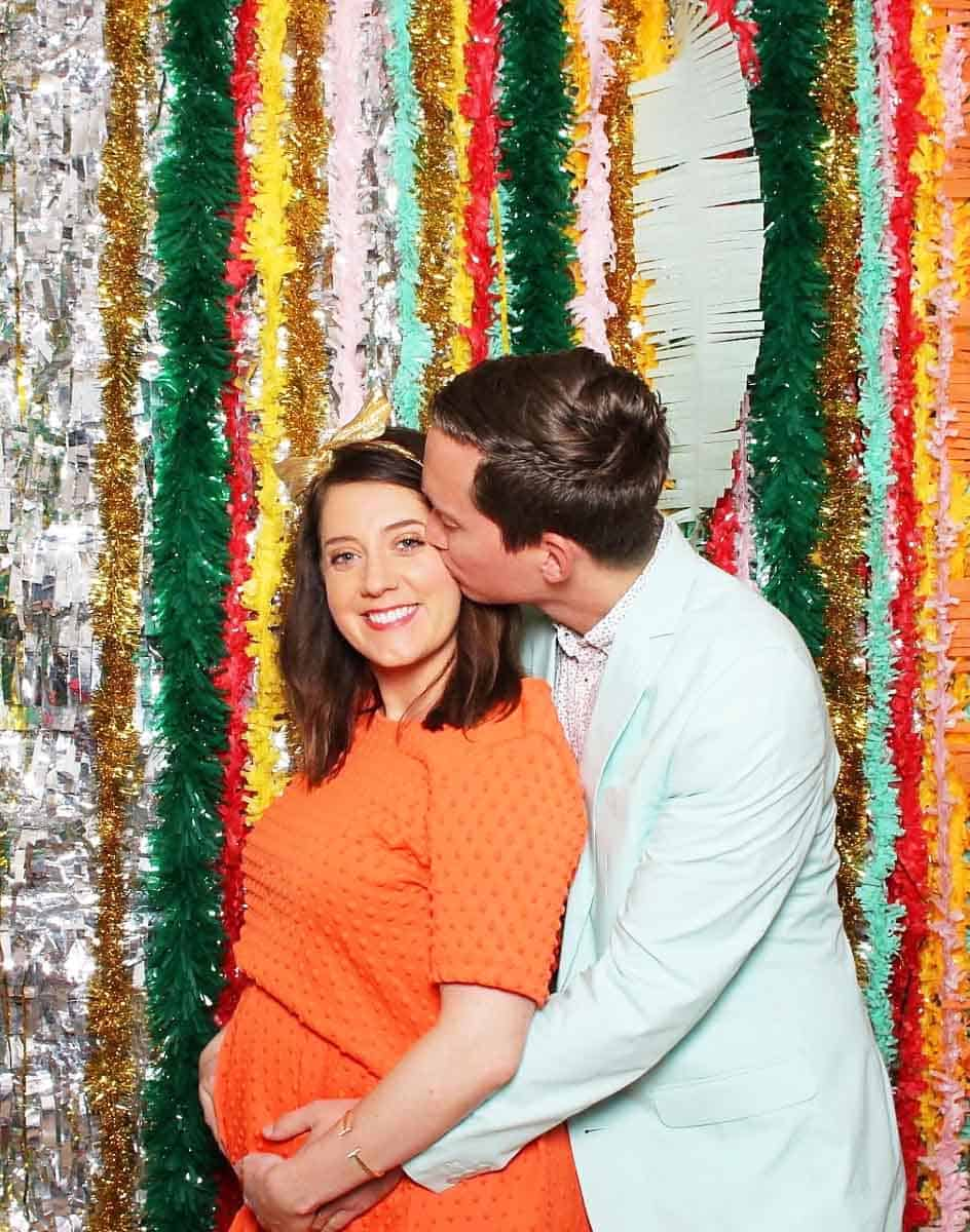 photo of a couple in a photo booth for gender reveal