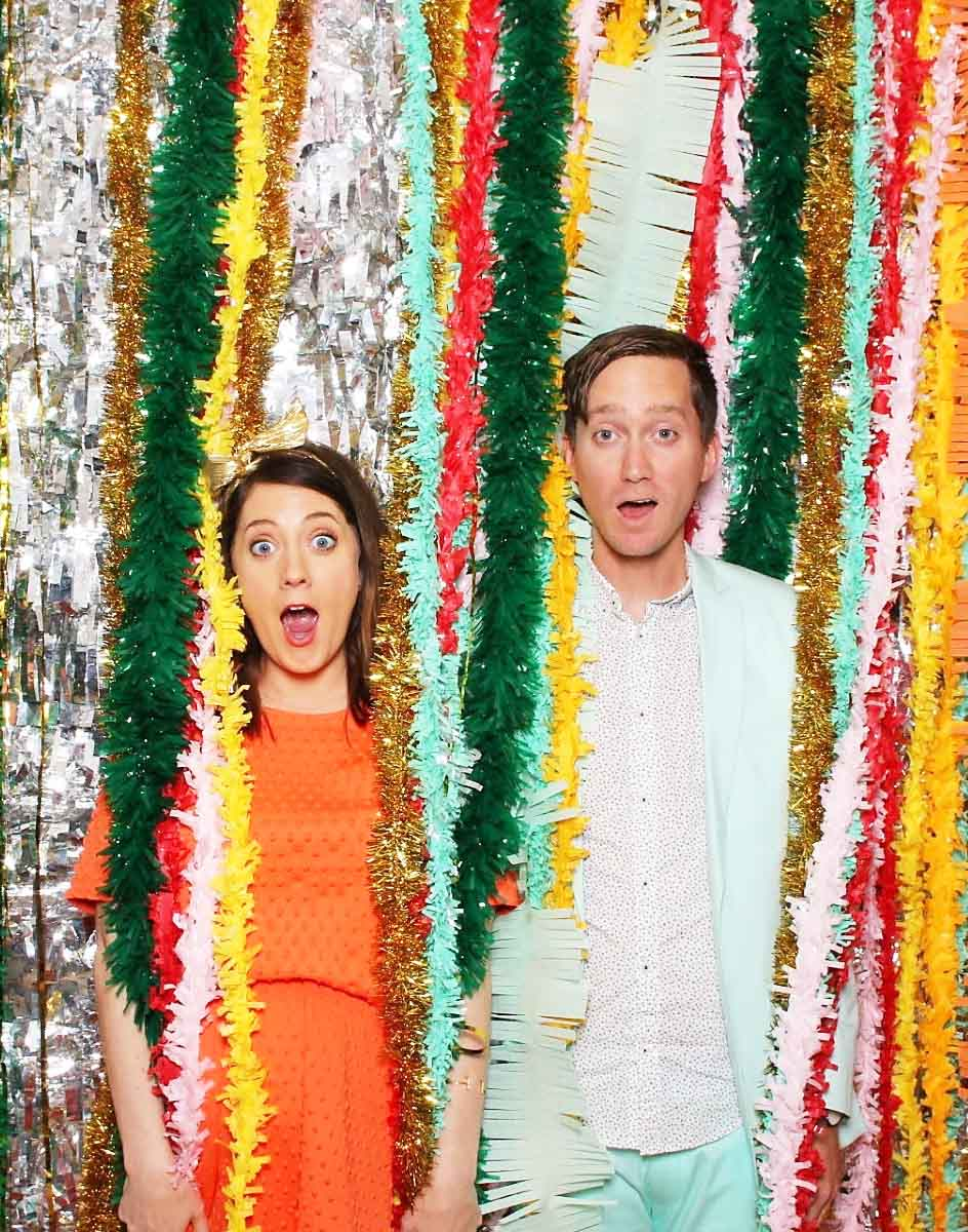 photo of a couple with streamers in a photo booth