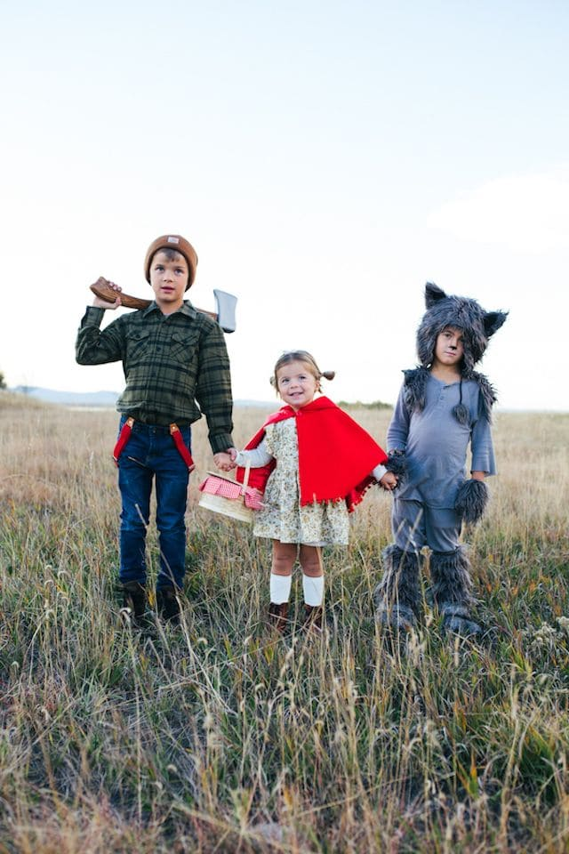 Photo of 3 siblings in Little Red Riding Hood inspired Halloween costumes