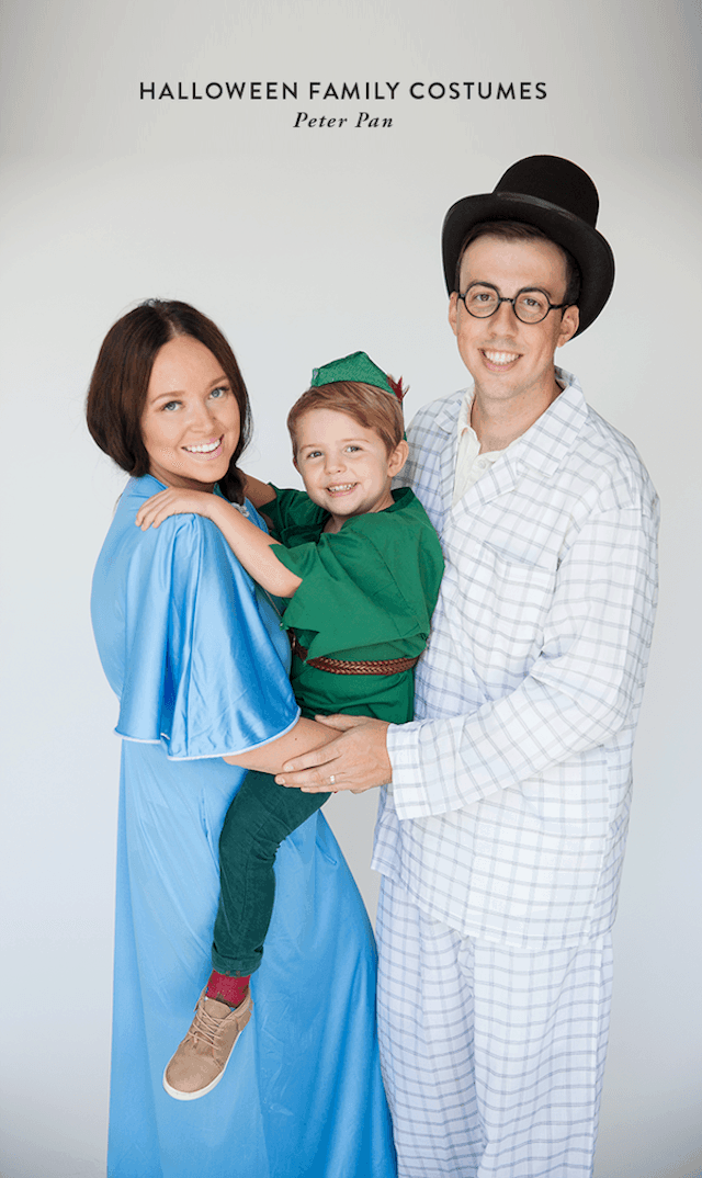 Photo of parents and child dressed in Peter Pan character Halloween costumes