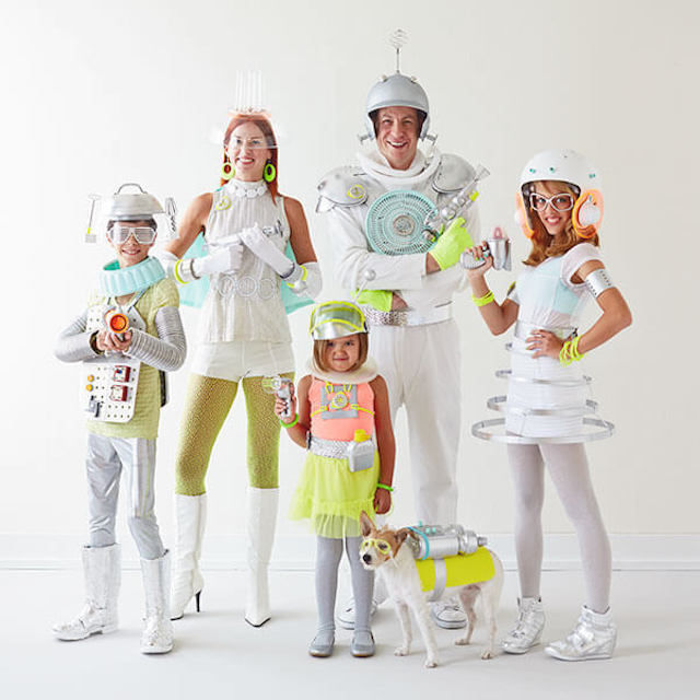 Photo of family and dog dressed in futuristic space costumes