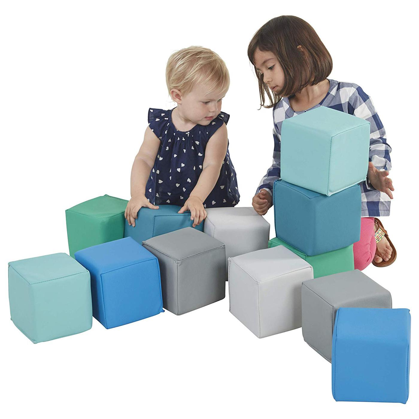 photo of two little girls playing with soft 1ft building cubes