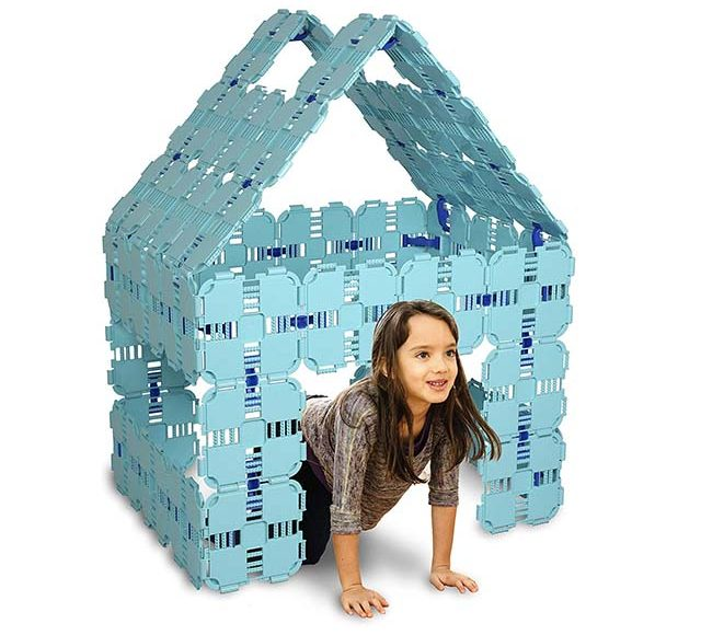 photo of young girl in collapsible toy house