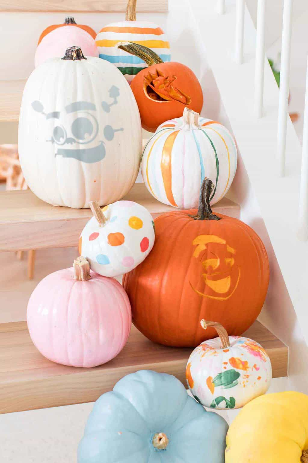 photo of a pile or carved pumpkin stencils and on stairs