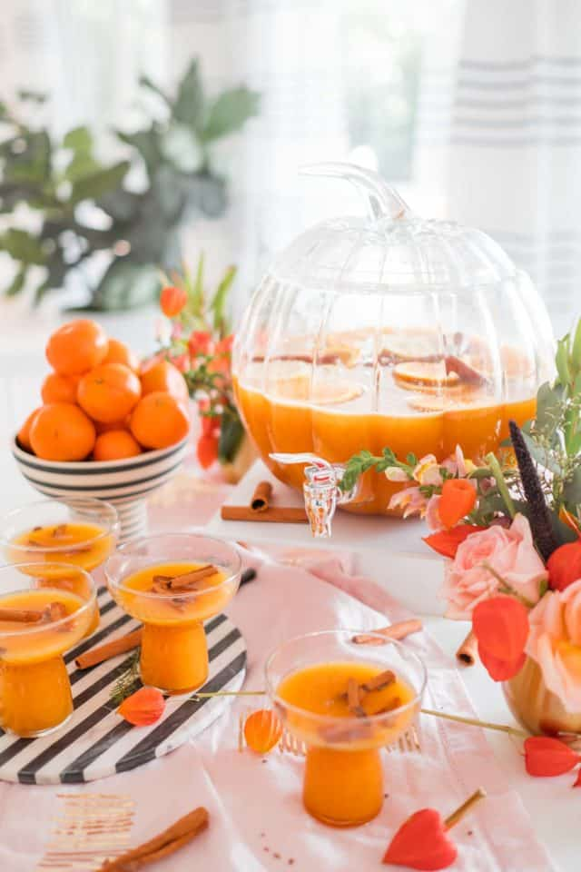 photo of a pumpkin punch bowl and thanksgiving cocktail