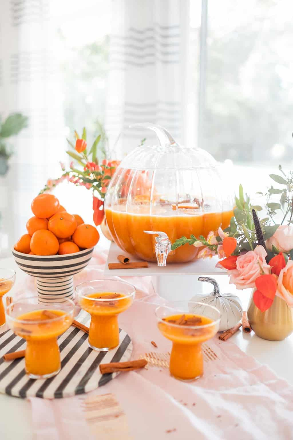 photo of thanksgiving cocktails and pumpkin punch bowl