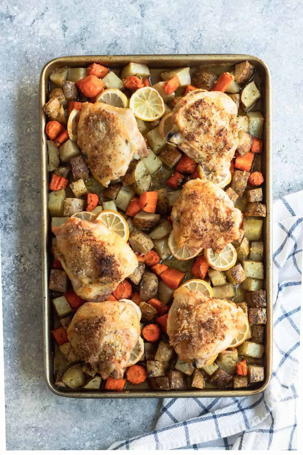 photo of the healthy and easy Rosemary Lemon Chicken Sheet Pan Dinner by top Houston lifestyle blogger Ashley Rose of Sugar & Cloth
