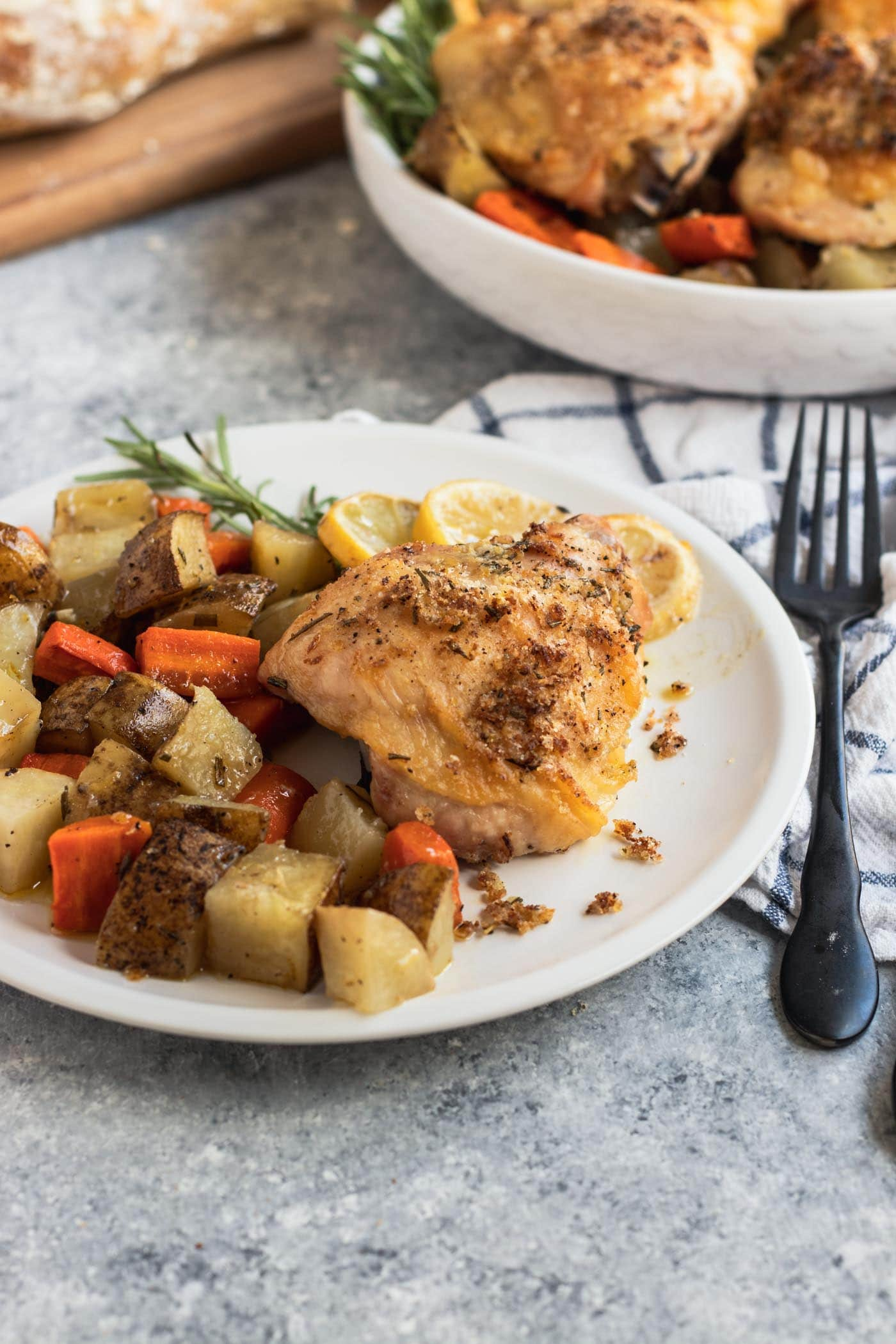 photo of the baked chicken and sides in sheet pan dinner recipe by top Houston lifestyle blogger Ashley Rose of Sugar & Cloth