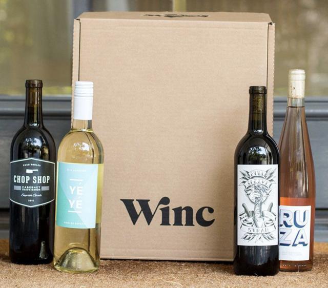 bottled wine gift box set on a doorstep
