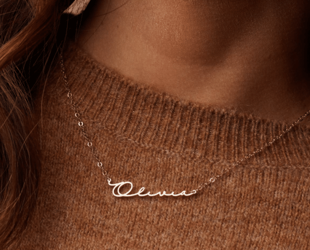 a girl wearing a custom name necklace