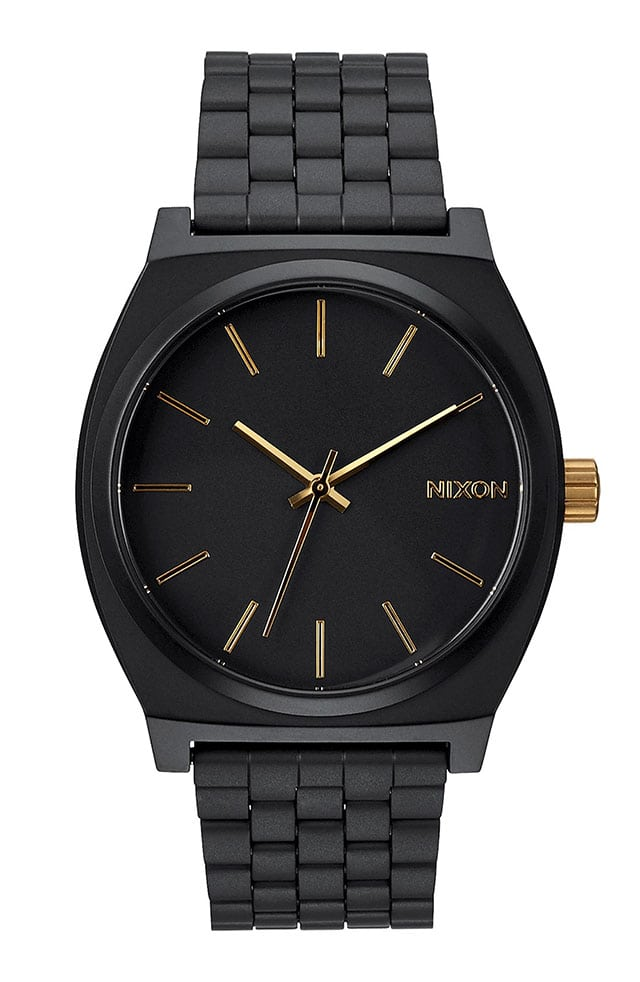 photo of a matte black and gold Nixon men's watch