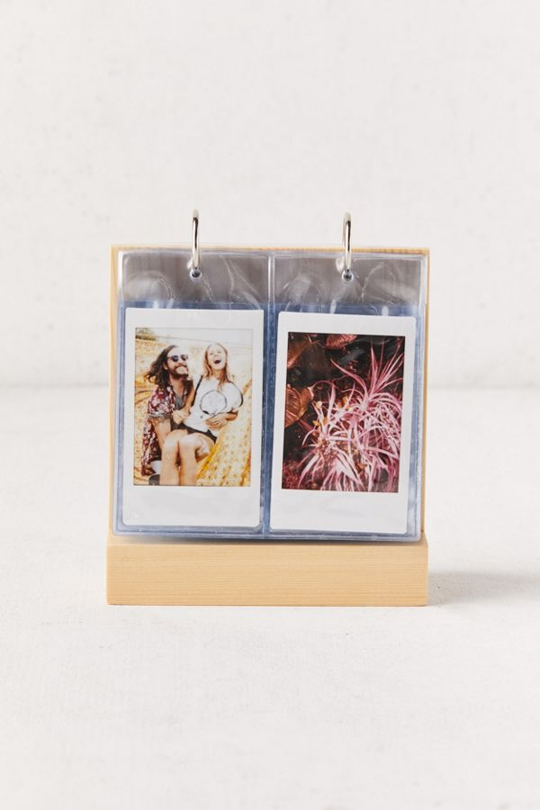 photo of a gold flip frame for instant photos