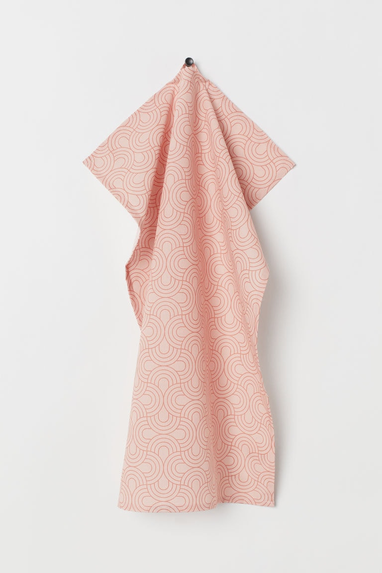 photo of a pink tea towel hanging