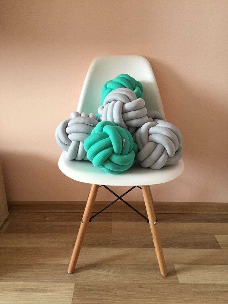 photo of knot pillows on a chair