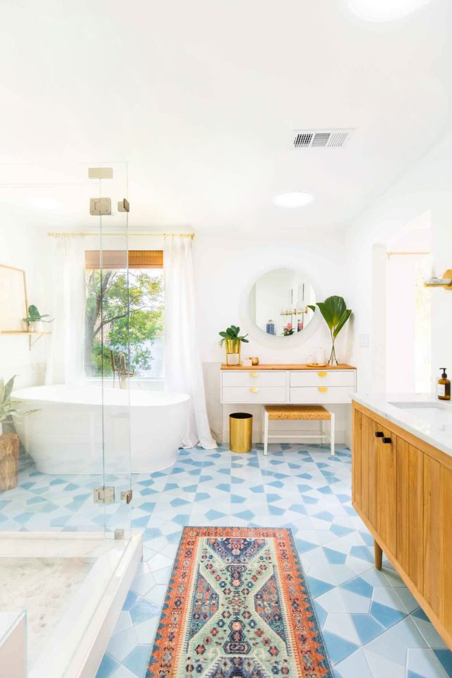 vertical photo of a master bathroom reveal