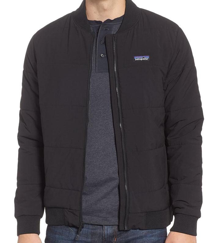closeup photo of a man wearing a Patagonia bomber jacket
