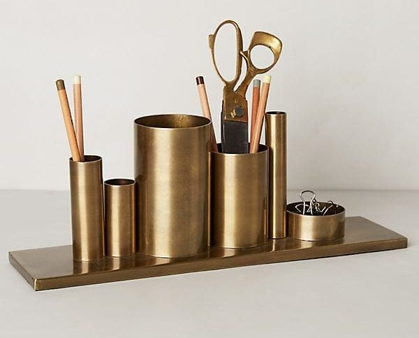 photo of a brass pencil holder
