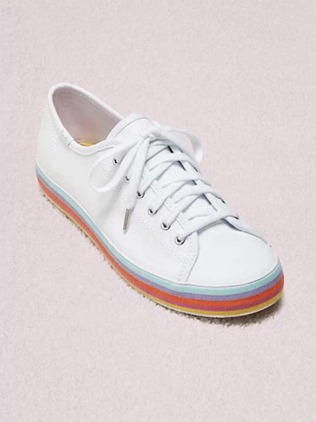 photo of white sneakers with colorful soles